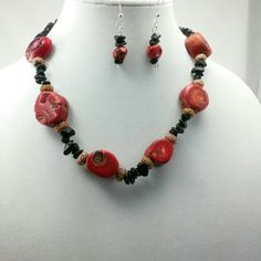 Beautiful Red Sea Coral and Black Onyx Set This is a beautiful Red Sea Coral and Black Onyx necklace set that is a very gorgeous and will add the finishing touches to your evening outfit. It's a one of a kind!!!! Jewelry