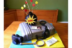 Ultimate Spy Cake with all the gadgets.