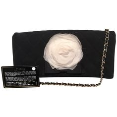 Preowned Chanel Black And White Quilted Silk And Nylon Camellia Flower... (70.895 RUB) ❤ liked on Polyvore featuring bags, handbags, clutches, white, white and black purse, white and black handbags, chain strap purse, chanel purse and black and white purse