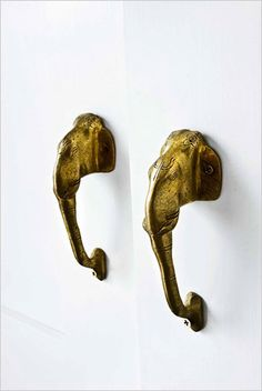 Brass elephant-head door handles purchased at an outdoor market in Katmandu.  (Tour: A Catskills Fishing Cottage - NYTimes.com)