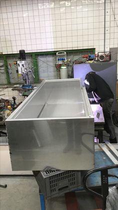 Welding a new aluminum storage box.