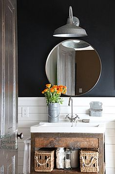 great sink and cabinet, wall color, barn light, wood wall, and check out the silver door!