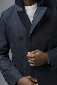 The Nautica Raw Denim Peacoat. This piece includes all the time-honored peacoat details—double-breasted button closures, welt pockets, notched collar—but the unexpected update is the deep-dyed indigo denim we used to craft it. The perfect gift for him this season