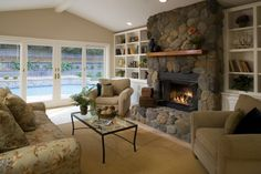 The perfect stone fireplace for this space, paired with a lovely mantel shelf to showoff your pictures and collectibles.