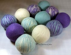 Dreamy Swirl set of 12 wool dryer balls by CleanSypria (http://www.etsy.com/listing/78511243/wool-dryer-balls-dreamy-swirl-set-of-12) Colors: Baby Blue, Lavender, Natural
