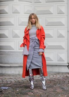 Top off your stripes with a checked wrap skirt in shades of gray, then throw on a pair of statement boots and some bright outerwear. #StreetStyle