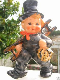 HUMMEL Goebel figurine from W. It is of a chubbycheeked little CHIMNEY SWEEP. The figurine stands approximately 5 inches tall and has the inc. Goebel Figurines, Chimney Sweep, Garden Sculpture, Miniature, Germany, Vibrant, Dolls, Antiques, Painting