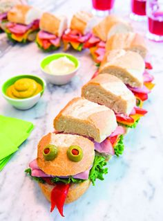 Sea Monster Sub: Feed a crowd with this supersize sandwich that kids can help pr. - kids snacks Sea Monster Sub: Feed a crowd with this supersize sandwich that kids can help pr… Food Art For Kids, Cooking With Kids, Party Food For Kids, Children Cooking, Kids Cooking Recipes, Cooking Food, Cute Food, Good Food, Funny Food