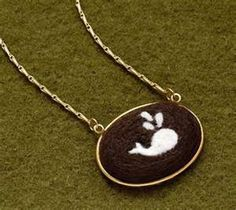 I wonder if I could buy up old cameos and other pendant necklaces to create these in?-fiber arts