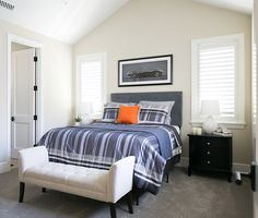 The bedroom decor is quiet and perfect for a teen boy. I like the quiet and masculine decor found here. This room is great for a teenage boy.  Patterson Custom Homes. Brandon Architects, Inc.