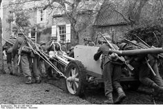 German soldiers with a Panzerabwehrkanone 7,5cm Pak ( anti-tank cannon).North France  	October 1943