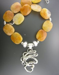 A necklace with Golden Quartz and a large SS pendant. Designed and made by Charlene Biesele.
