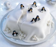 Iced cake with iceberg detailing and black and white penguins sitting on top(Winter Cake Ideas) Christmas Cake Designs, Christmas Cake Decorations, Holiday Cakes, Christmas Desserts, Christmas Treats, Christmas Cakes, Xmas Cakes, Christmas Christmas, Christmas Recipes