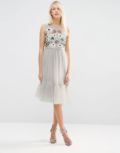 bead and sequin embelishment make the Tulle Woodland Embellished Midi Dress a dream - get even more style and shopping inspiration on http://jojotastic.com/shop-my-favorites/