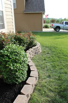Ever since I moved into my current house, I wanted to add a retaining wall right off our front porch. Our yard slants to the right, and our . Diy Retaining Wall, Landscaping Retaining Walls, Outdoor Landscaping, Front Yard Landscaping, Outdoor Gardens, Landscaping Ideas, Retaining Water, Garden Stepping Stones, Star Wars
