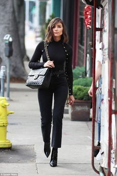 Olivia Culpo wearing Chanel Quilted Flap Xl Bag, Jean Atelier High Rise Flip Jeans in Lava and Are You Am I Selya Top