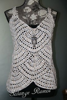 You can make the top into a dress simply adding rows of motifs.