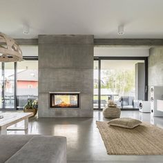 The is a Single-Sided bay style, trimless, electric fireplace by Electric Mo. - The is a Single-Sided bay style, trimless, electric fireplace by Electric Modern proportioned t - Minimalist House Design, Minimalist Home, Modern House Design, Home Fireplace, Fireplace Design, Two Sided Fireplace, Custom Fireplace, Concrete Fireplace, Concrete Interiors