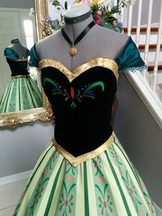 This is Annas Frozen Coronation dress. It consists from a corset top and a skirt. The corset is made out of stretch velvet. Embroidered design
