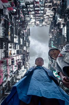 2014, Hong Kong, Hong Kong Island. My take on this famous apartment complex in Quarry Bay.  These siblings were so kind to be my models for the shot. Camera was on the ground, facing up, and triggered via WiFi from the smartphone app.