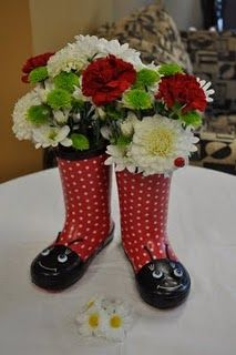 How cute is this??- decoration by front door for the spring! Use the raing boots your kids have grown out of.
