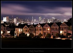 Painted Ladies Victorian houses at Alamo square and downtown - San Francisco, California, USA