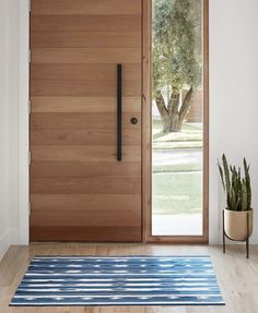 Right on hue. the all-natural indigo Saagar Dhurrie Rug certainly knows how to make an entrance. Modern Entrance Door, Modern Exterior Doors, Modern Front Door, Wood Front Doors, Front Door Entrance, House Front Door, Front Door Design, House Doors, House With Porch