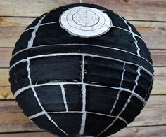 Having a Star Wars party? Here's how to have your own Death Star Paper Lantern!Materials: Glue, Scissors, Black Table Napkin, Black Permanent Marker & Printable Laser Circle