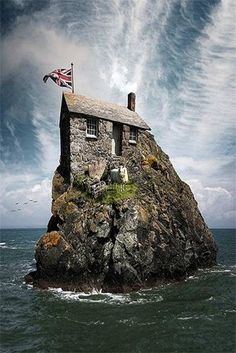 """Real life hut on the rock (with Cow). ~ Miks' Pics """"Houses"""" board @ http://www.pinterest.com/msmgish/houses/"""