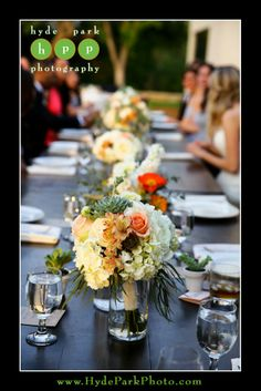 Breathtaking Blooms provided fun, whimsical floral arrangements for this rustic wedding, with flowers like white hydrangea, green succulents, peach roses, and orange alstroemeria. Photo by Austin Wedding Photographer, Hyde Park Photography. The Vineyard at Chappel Lodge | ILD lighting | Breathtaking Blooms | Sprinkles Dallas Cupcakes | Austin Wedding Planners by Rosa. @Rosa Gibson