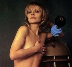 Another of the Doctor's (Jon Pertwee) companions, Jo Grant (Katy Manning) in a bit of a risque Dalek pose.That's GOTTA be cold on sensitive areas! Doctor Who Assistants, Jon Pertwee, Doctor Who Companions, 3 Movie, Dalek, Dr Who, Mad Men, Erotica, Science Fiction