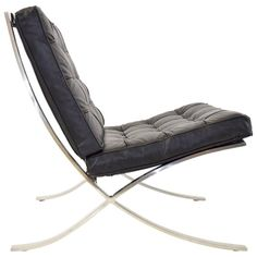 Ludwig Mies van der Rohe Barcelona Chair in Stainless Steel and Black Leather | From a unique collection of antique and modern lounge chairs at https://www.1stdibs.com/furniture/seating/lounge-chairs/
