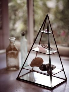 Inspired by the pyramids at Giza and handmade in Philadelphia, this stained glass pyramid has three shelves and a hinged front door. Perfect for holding your favorite rings or displaying your crystals. Copper trim. *By ABJ Glassworks