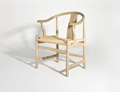 No, the craftsmen who built this chair didnt grow a tree in this shape. But it sure looks like it. The gentle curves of the arms and posts take a page right out of nature, as does the framing that rises up to greet it at the seat. The seat itself is meticulously woven of cord, creating a resting place that is firm yet giving, artistic yet practical. Youd think that this chair should be gracing a fine art museum, but thankfully, it is ready to grace your home instead.