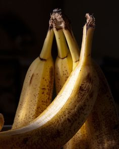 I created this banana fruit still life photograph in natural light. I enjoyed the peeled softness of the ripe bananas against the golden yellow and warm freckled spots with the black background. This