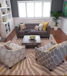gray sofa with dark walls and white wainscoting