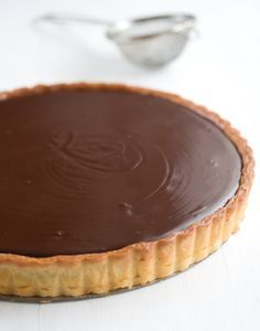 Extraordinary Chocolate Tart with an Almond Shortbread Crust - This completely decadent tart is made with Valrhona Guanaja chocolate and is indeed every bit as it is described, extraordinary. Tart Recipes, Baking Recipes, Sweet Recipes, Sweet Pie, Sweet Tarts, Pie Dessert, Dessert Recipes, Just Desserts, Delicious Desserts