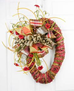 This wreath design can be used either on a door, or by simply laying it on a table, create a beautiful centerpiece. Add a candle or other fall elements to compl