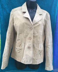 "Beige tan suede leather jacket by Outer Edge. This jacket is 100% leather outer with 100% polyester lining, womens size Large, and has two button-close front pockets and three 1"" buttons down the front. 