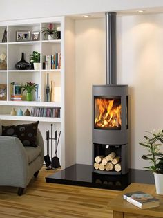 - Dovre Astroline Wood Burner with Wood Store Base Contemporary Wood Burning Stoves, Modern Stoves, Log Burner Living Room, Wood Burner Fireplace, Fireplace Hearth, Fireplace Kitchen, Log Burning Stoves, Wood Fuel, Freestanding Fireplace