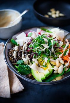 """Lentil Veggie Bowl with avocado, carrots, radishes, sprouts, """"activated"""" almonds & a quick """"Hummus"""" Dressing...a delicious lunch or dinner that is filling and Detoxing! 