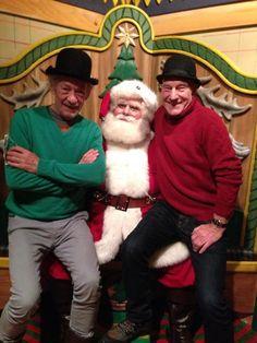 Patrick Stewart and Ian McKellan sit on Santa's lap at Macy's Santaland in New York City in this photo tweeted by Stewart.