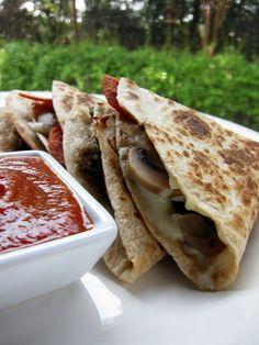 Pizzadilla - Quick & easy dinner..wheat 100 calorie tortilla, chicken, spinach,  low fat feta, onion, pizza sauce and mozzarella