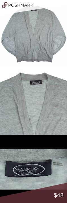 """MAGASCHONI 100% Cashmere Poncho Cardigan Sweater Excellent condition! This gray Cashmere tissue knit cardigan from MAGASCHONI features a open front like a cardigan, but it's also styled like a poncho at the sleeves. Very light weight - a tissue knit. Made of 100% Cashmere. Measures: bust: 44"""", total length: 27"""" Magaschoni Sweaters Cardigans"""