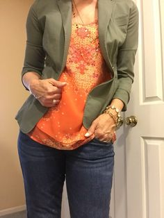 Olive jacket (spring 15), Merrow Edge tank (spring 15), destructed boyfriend jean (fall 15). Cabi.