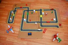 printable road maps - mod podge buildings onto painted white wood blocks with velcro on bottom & use old pizza box