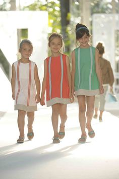 Fendi, sharp little girls dresses with a slightly darker orange shade for summer 2012
