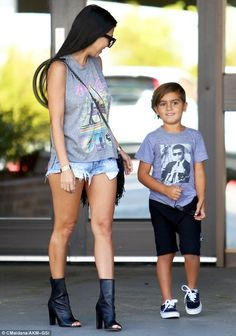 Loving it: Kourt could hardly wipe a smile off her face...