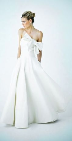 Bold bow wedding gown (a favourite repin of VIP Fashion Australia www.vipfashionaustralia.com - Specialising in unique fashion, exclusive fashion, online shopping sites for clothes, online shopping of clothes, international clothing store, international clothes shop, cute dresses for cheap, trendy clothing stores, luxury purses )
