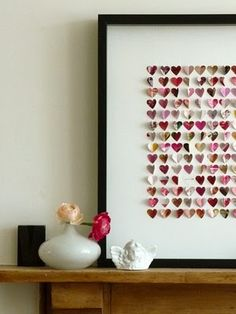 hearts.  Fill the frame with tiny handcut hearts folded in half and glued on the fold.  Add several flat white ones with names or dates spread throughout.  Such as wedding or anniversary.  Very cute.